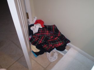 Natalie's clothes behind the bathroom door
