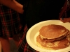 Students were served 3 pancakes at a time, two suasage links and a drink. The pancakes were unlimited and last for both lunch/activity periods.