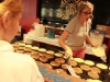 Werkowitch scooping pancakes off the gridle before serving students Aug. 23.