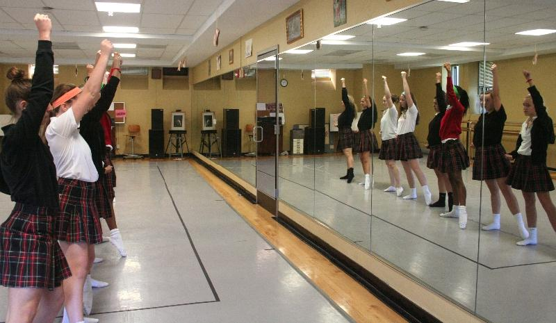 STA dance team practices for an upcoming performance Oct. 26 in the M&A Building dance studio. The next day the dance team performs at Rockhurst High School's football game during halftime.