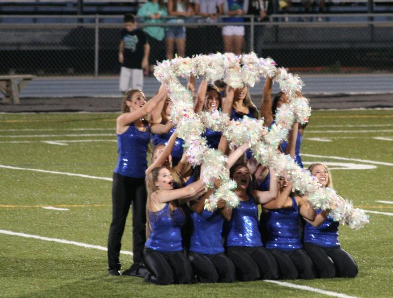 The STA dance team performs during halftime of the Rockhurst High School football game Sept. 28. During their performance they made an R,H and S to celebrate the team.