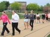 "Students walk around the track during the ""Out of the Darkness"" event April 27. The event helped to raise awareness about teen depression and suicide. Photo by Allison Fitts"