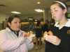 "Freshmen Mireya Ramirez, left, and Megan Ehrnman eat donuts at the ""Out of the Darkness"" event April 27. Photo by Allison Fitts"