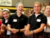 Seniors Emily McCann (left), Coutney Coppinger (center), and Jane Evans (right) are enjoying the ending song at the