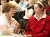 Ms. Pat Smith, left, and junior Adelle Smith eat sugar cookies and talk during the Grandmother's Tea.