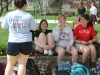 Seniors Alex Greathouse, from left, Katarina Waller, Hannah Otto, and Paige Wendlend visit on a bench in the Quad during the TNT yard day Mar. 30.