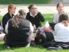Juniors talk and finish their homework as they sit in the Quad during the TNT yard day Mar. 30.