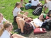 Sophomore Erin Farmer laughs with her freinds while lounging in the Quad during the TNT yard day friday, Mar. 30.