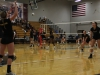 Holli Hogge and Anna Kropf warm up before the Stars' volleyball game against Lee's Summit West August 25 at St. James Academy.