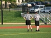 Referees talk during a timeout at the varsity lacrosse game on Kevin Gray field Friday April 13. Referees called a foul on Barat Academy with 15 minutes to play giving Freshman Anna Meagher a change to score.