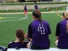 Members of the 'P-Squad' Brookside Soccer team talk and relax on the bench as they watch their teammates lead the game at St. Teresa Academy's Kevin Gray Field on Saturday, April 14. The P-Squad won the game 4-1. By Sabrina Redlingshafer