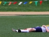 Rockhurst High School sophomore Doc Reed takes a break to lay down during the P-Squads game at St. Teresa Academys Kevin Gray Field on Saturday, April 14. Reed plays most often plays goalie for the team. By Sabrina Redlingshafer