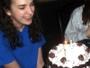 Freshman Ellen Weitkamp blows out the candles on her birthday cake on the back porch of her Leawood home April 13. Weitkamp turned sixteen.