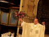 Father Patrick Rush blesses the communion bread and wine during the Easter Vigil. Father Rush has served at Visitation Parish since 2005 and was the priest who performed this year's Easter Vigil. By Grace Sly