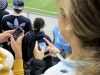 Seniors Megan Hodes, left, and Hannah Reinhart update Twitter about the Sporting KC game at the Livestrong Sporting Park Saturday April 14.  Reinhart updated her Twitter shortly after being showed on the Video Board during the game.  By Lindsey Valdiviez