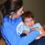 Senior Morgan Bene tickles her nephew Beau Verstraete. photo by Shaeffer Smith