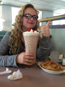 Sophomore Mackenzie O'Guin poses by the infamous Winstead's Skyscraper. Unknown to most, the secret ingredient in said milkshake is undiluted self-loathing.