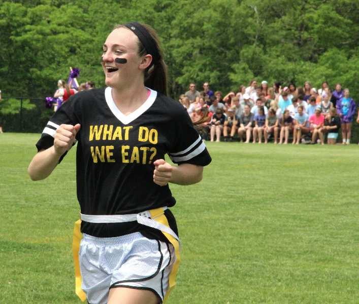 Becca Lueke does a celebration dance as she walks off the field during the senior powderpuff game against Notre Dame de Sion May 20, 2013. photo by Caroline Fiss