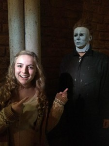 Sophomore Mackenzie O'Guin points lovingly at Michael Myers. She took this photo to send to family friend and local musician Tech N9ne, who loves horror films. photo by Christina Kirk