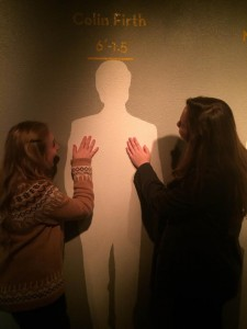 Sophomores Mackenzie O'Guin and Christina Kirk lovingly gaze at silhouette of Colin Firth, reminiscing on his role in Pride and Prejudice. photo by Travis O'Guin